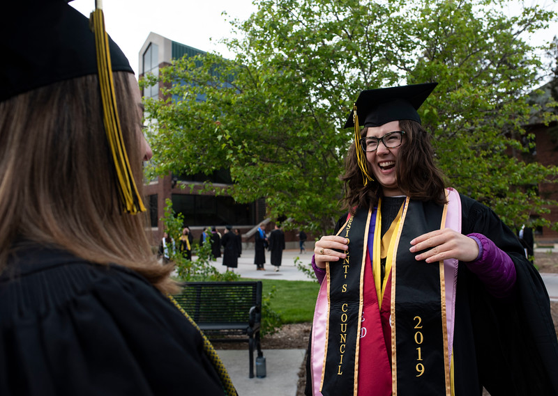 Graduate Ines Siepmann puts on her five stoles before the 2019 commencement ceremony at Colorado College in Colorado Springs, Sunday, May 19, 2019. (Photo by Kelsey Brunner/The Gazette)