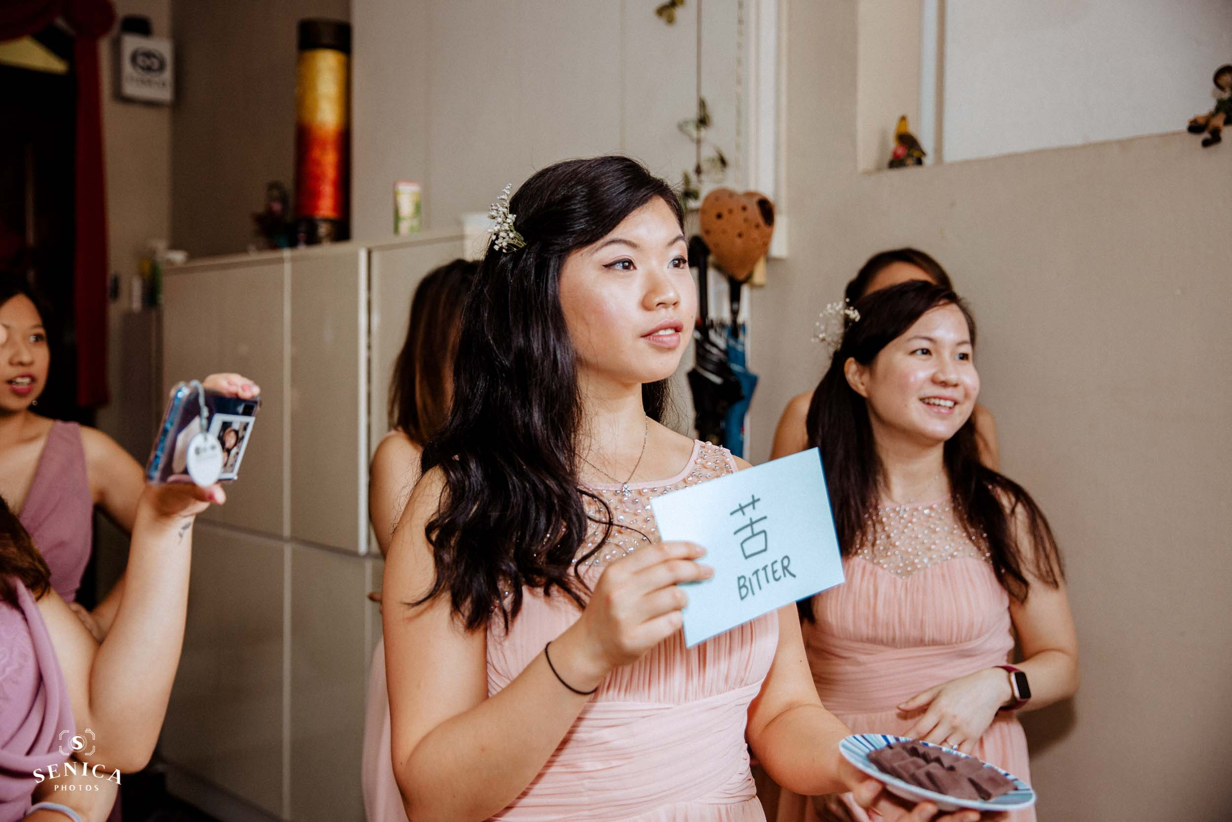 Bridesmaid holding a plate of chocolates for the 'Ku' part of the flavour tasting challenge