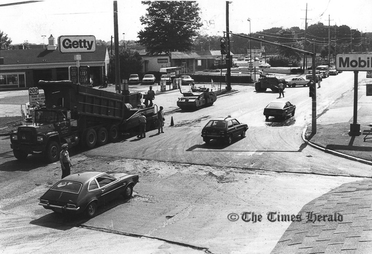 . This Times Herald file photo dated Sept. 1, 1983 shows traffic moving cautiously on eastbound Route 73 in Whitpain Township as workmen completed resurfacing its intersection with route 202. The $748,000 project, in two phases, also included installing a box culvert across the Stoney Creek on Route 202 south of Montgomery County Community College and new drainage and widening of Route 202 at Morris road. A two-week detour \' Route 202 between Morris road and Route 73 began Aug. 27, 1983.