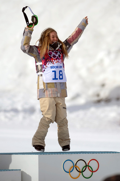 . ROSA KHUTOR, RUSSIA - FEBRUARY 09: Gold medalist Jamie Anderson, of the United States, celebrates on the podium after winning the women\'s snowboard slopestyle final. Sochi 2014 Winter Olympics at the Rosa Khutor Etreme Park on Sunday, February 9, 2014. (Photo by AAron Ontiveroz/The Denver Post)