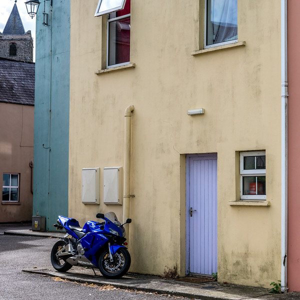 Motorcycle parked outside a house on the street, Kinsale, County Cork, Ireland
