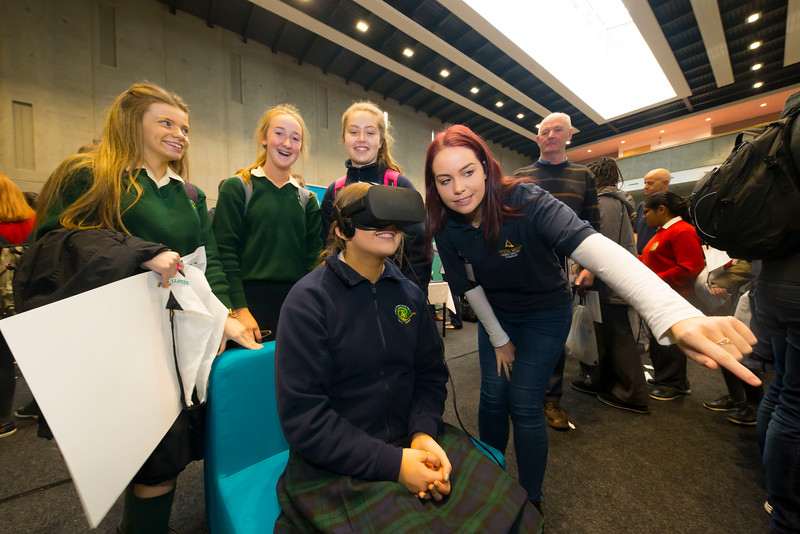 "09/11/2017. Crystal Valley Tech Showcase at WIT Arena. Pictured is Grainne Flannery from St Mary's Secondary School, New Ross Co. Wexford with Claire Coppinger from Bluefin with a VR Head Set. Picture: Patrick Browne  with Grainne Flannery from St Mary's Secondary School, New Ross Co. Wexford. Picture: Patrick Browne   Event demonstrates Tech and ICT is thriving in Wexford and the South East 50 companies and 2,000 students, industry and recruiters attend the inaugural Crystal Valley Tech Showcase event  Over 50 companies who are working together as Crystal Valley Tech showcased their rapidly growing industry in the WIT Arena on Thursday morning to approx. 2,000 members of the public, college and second level students, recruiters, government agencies and other industry.  The future is bright for ICT in the South East according to Dr Padraig Kirwan, Head of the Department of Computing & Mathematics at Waterford Institute of Technology. ""Computing is thriving in the South East judging by the number and diversity of ICT companies here today. Even more encouraging is the number of second level students who attended from Waterford, Kilkenny, Carlow, Tipperary and Wexford and how interested they are about the career opportunities in this exciting industry.""  Wexford schools attending the event included St. Mary's CBS in Enniscorthy, St Mary's Secondary School in New Ross and Colaiste an Atha in Kilmuckridge.  Elaine Fennelly, Bluefin Payment Systems General Manager and co-founder of Crystal Valley Tech is very excited about the industry in the South East and today's showcase event. ""People who work in the industry already know that Tech is well established in the South East and the number of opportunities and companies continues to grow and grow. According to a recent Tech Ireland report there are over 60 indigenous and multinational companies employing well over 1,500 people from their bases in Waterford, Wexford, Kilkenny and Carlow.  ""However, we weren�"