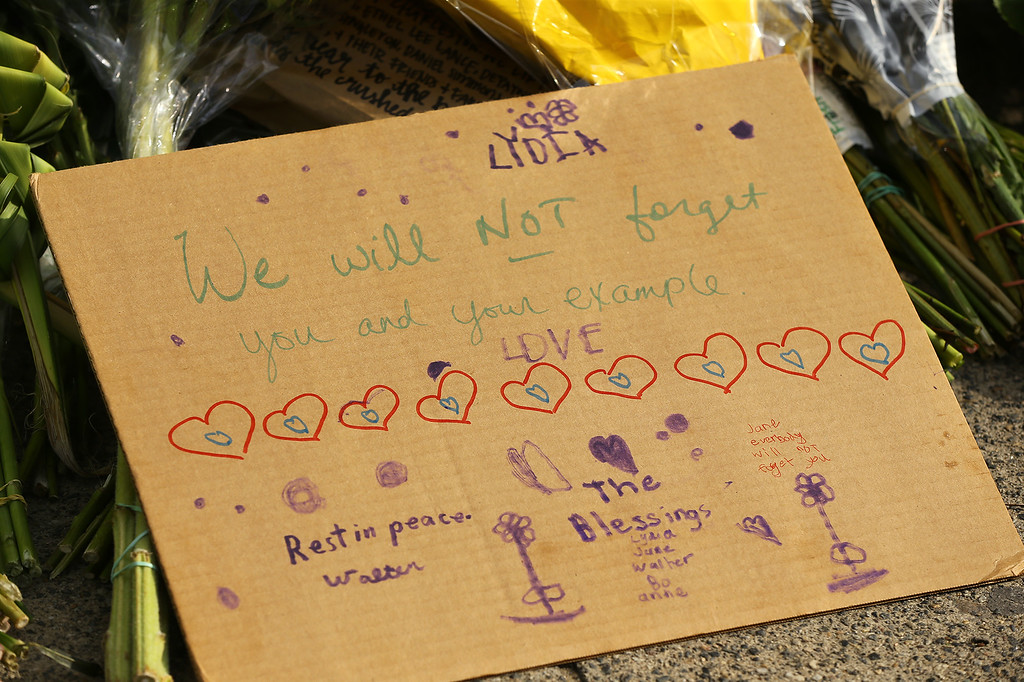 . A hand written note by Lydia Blessing, 4, Charleston, that includes 9 hearts for each of the victims lays on a memorial in front of the Emanuel AME Church on Friday, June 19, 2015 in Charleston, S.C.  Dylann Storm Roof, 21, is accused of killing nine people during a Wednesday night Bible study at the church.   ( Curtis Compton/Atlanta Journal-Constitution via AP)