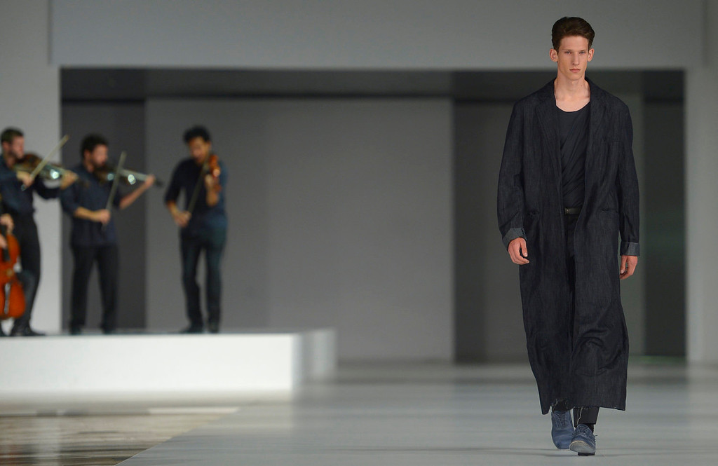 . A models wears a creation from Josep Abril during a 080 Barcelona fashion show in Barcelona, Spain, Thursday, July 11, 2013.  (AP Photo/Manu Fernandez)