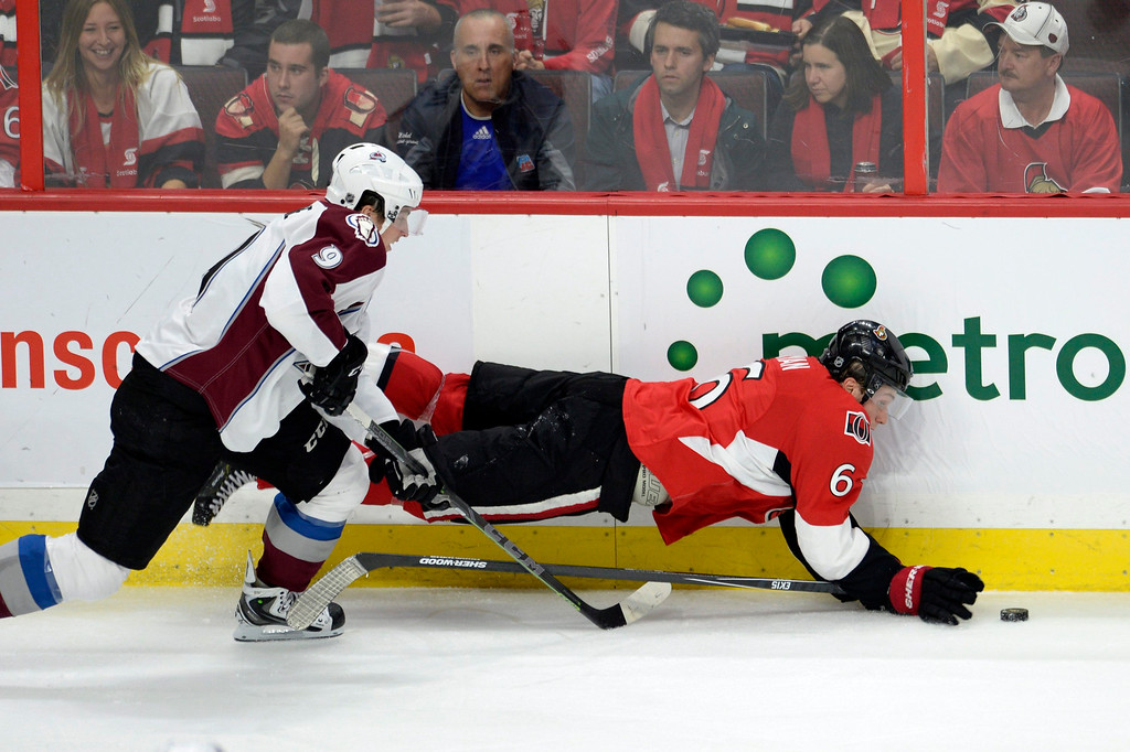 . Ottawa Senators\' Bobby Ryan (6) gets tangled up with Colorado Avalanche\'s Matt Duchene (9) during the second period of an NHL hockey game Thursday, Oct. 16, 2014, in Ottawa, Ontario. (AP Photo/The Canadian Press, Justin Tang)