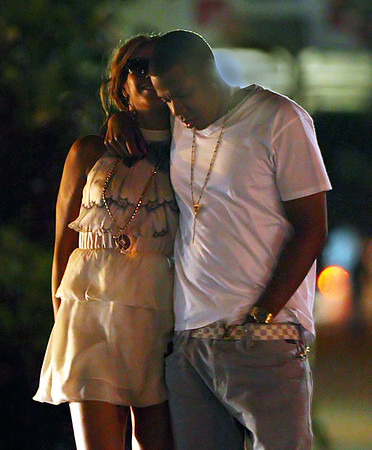 2009-07-14 - Jay-Z adjusts to married life with one arm around his wife and the other down his pants, Jay-Z strolled down a NYC street with Beyonce