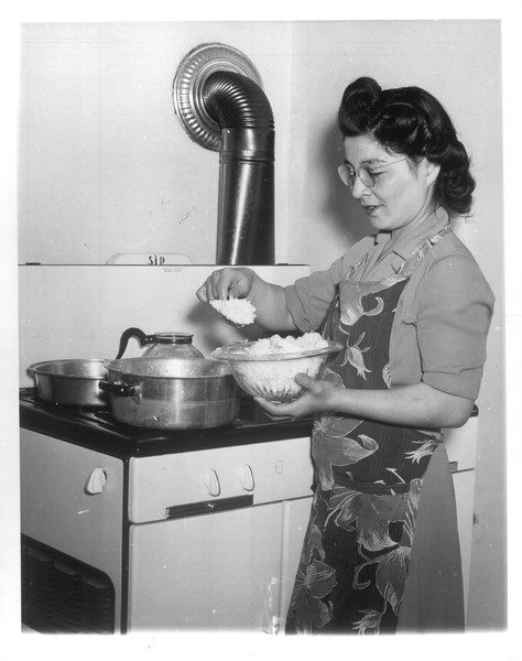 """""""Japanese-American Homecoming -- Only the Japanese-American with a job and a place to live, or an approved plan for the future will be aided by the War Resettlement Administration in returning to the Coast"""" -- caption on photograph"""