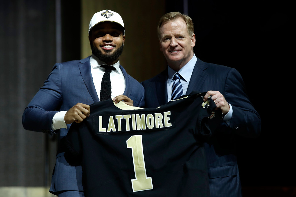 . Ohio State\'s Marshon Lattimore, left, poses with NFL commissioner Roger Goodell after being selected by the New Orleans Saints during the first round of the 2017 NFL football draft, Thursday, April 27, 2017, in Philadelphia. (AP Photo/Matt Rourke)