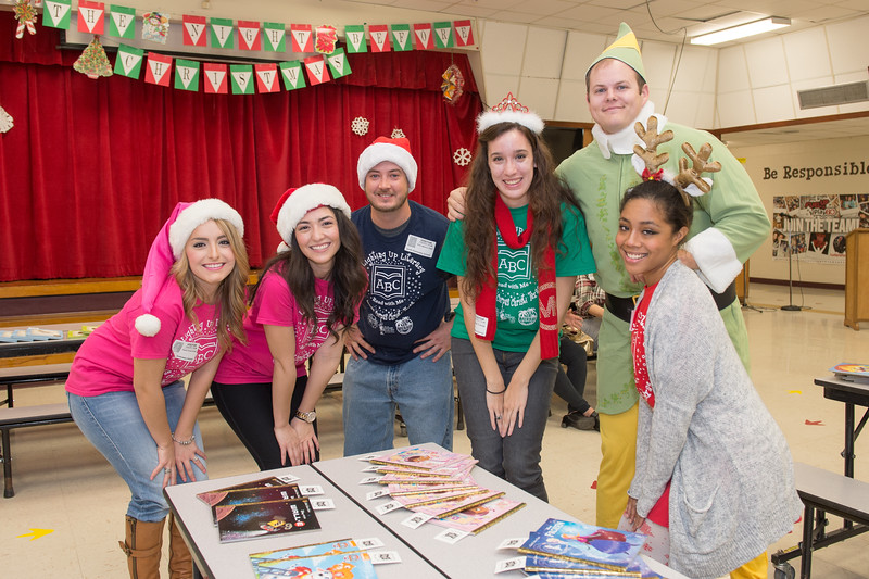 Shantay Breunig(left), Heather Selim, Ryan Ewart, Conner Tichota, Kyle Phillips and Cyma Mayes. Volunteers from TAMUCC, donated books to Smith Elementary students.