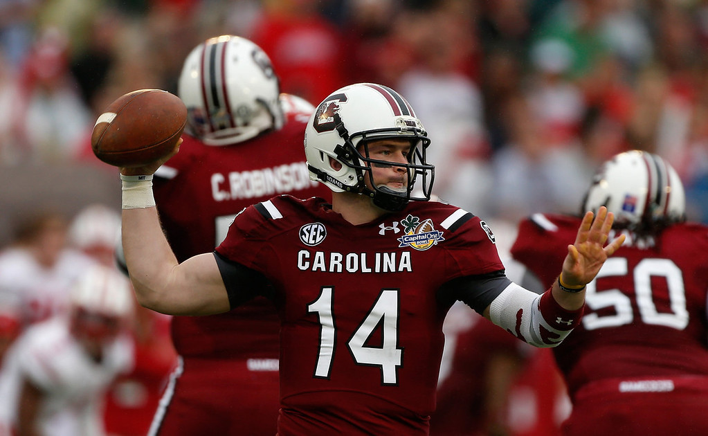 . Connor Shaw #14 of the South Carolina Gamecocks looks turnover pass during the first half of their game against the Wisconsin Badgers at the Capital One Bowl on January 1, 2014 in Orlando, Florida.  (Photo by Scott Halleran/Getty Images)
