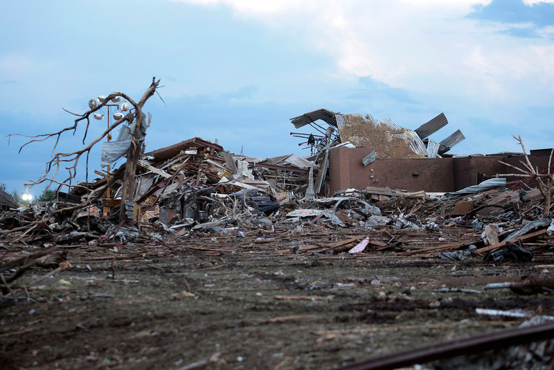 . Piles of debris lie around the northeast corner of Plaza Towers Elementary school after it was damaged by a tornado May 21, 2013 in Moore, Oklahoma. The town reported a tornado of at least EF4 strength and two miles wide that touched down yesterday killing at least 24 people and leveling everything in its path. U.S. President Barack Obama promised federal aid to supplement state and local recovery efforts.  (Photo by Brett Deering/Getty Images)
