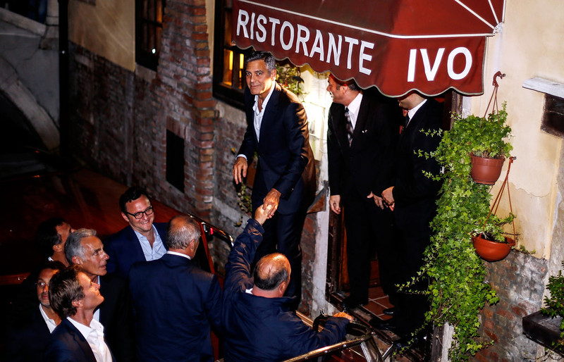 . George Clooney (top L) prepares to get in a boat as he leaves the restaurant Da Ivo with friends and his father during his stag night event in Venice on September 27, 2014. Clooney and his Lebanon-born British fiancee Amal Alamuddin arrived in Venice on September 26 for a spectacular waterfront wedding billed as the party of the year. Pierre Teyssot/AFP/Getty Images