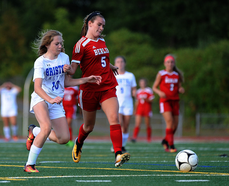 9/22/2017 Mike Orazzi | Staff Bristol Eastern's Kate Kozikowski (10) and Berlin's A. Derrelli (5) during girls soccer at Bristol Eastern Friday afternoon.