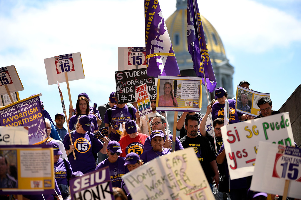 . Denver, CO - ARRIL 14: Denver�s low wage janitors  were joined by local homecare workers, Fast food, delivery persons and service workers during their  Underpaid Fight for $15 march. April 14, 2016 in Denver, CO. (Photo By Joe Amon/The Denver Post)