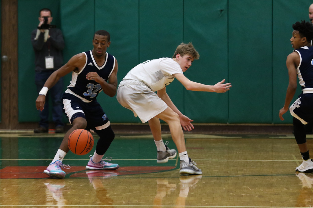 . 2018 - Basketball - Benedictine at Lake Catholic.  Benedictine defeated Lake Catholic 63-56.  Benedictine\'s Chris Jefferson (32) steals the ball from Lake Catholic\'s Luke Frazier (5).