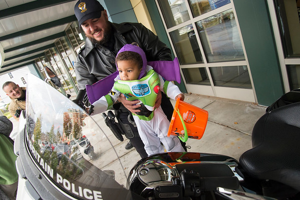 10/17/19 Wesley Bunnell | StaffrrThe New Britain YWCA held their fall festival on Thursday evening featuring visits from the police and fire departments. Marcus Brushie, age 2, holds his candy given out by Ofc. Kyle Cleary as he examines the motorcycle's lights.