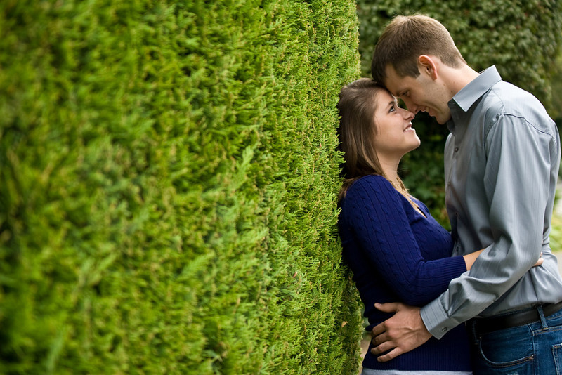 Engagement-couple-with-green-hedge.jpg