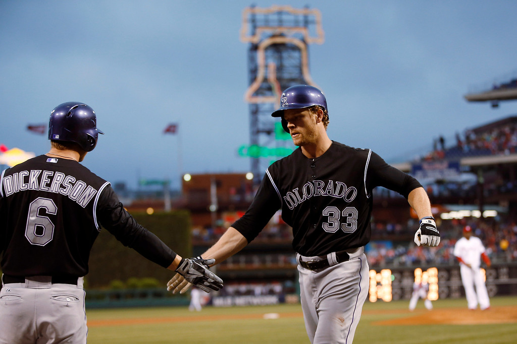 . Colorado Rockies\' Justin Morneau, right, celebrates with Corey Dickerson after hitting a home run off Philadelphia Phillies starting pitcher Roberto Hernandez during the third inning of a baseball game, Wednesday, May 28, 2014, in Philadelphia. (AP Photo/Matt Slocum)