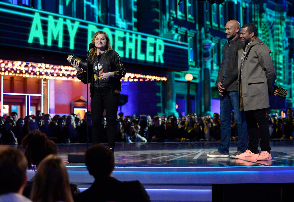 . Amy Poehler accepts the award for best virtual performance for �Inside Out� at the MTV Movie Awards at Warner Bros. Studio on Saturday, April 9, 2016, in Burbank, Calif. Looking on from right are presenters Jordan Peele and Keegan-Michael Key. (Kevork Djansezian/Pool Photo via AP)