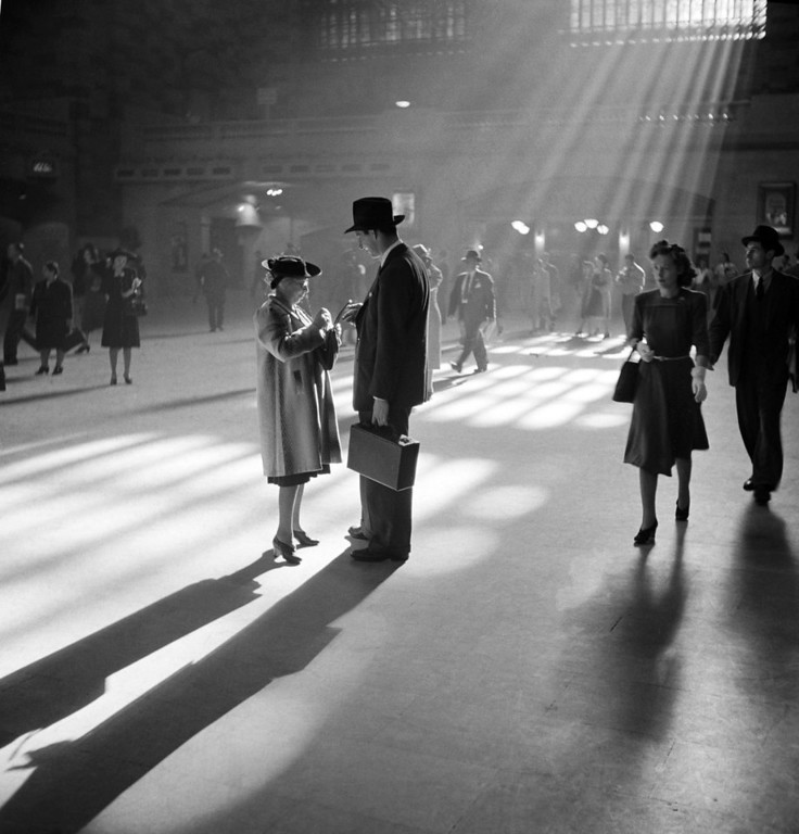 . A man and woman talk together as people pass through the Main Concourse of New York\'s Grand Central Terminal -- commonly known as Grand Central Station -- in Midtown Manhattan, in October 1941. (AP Photo/Farm Security Administration, John Vachon)