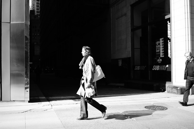 Woman walking in contrast
