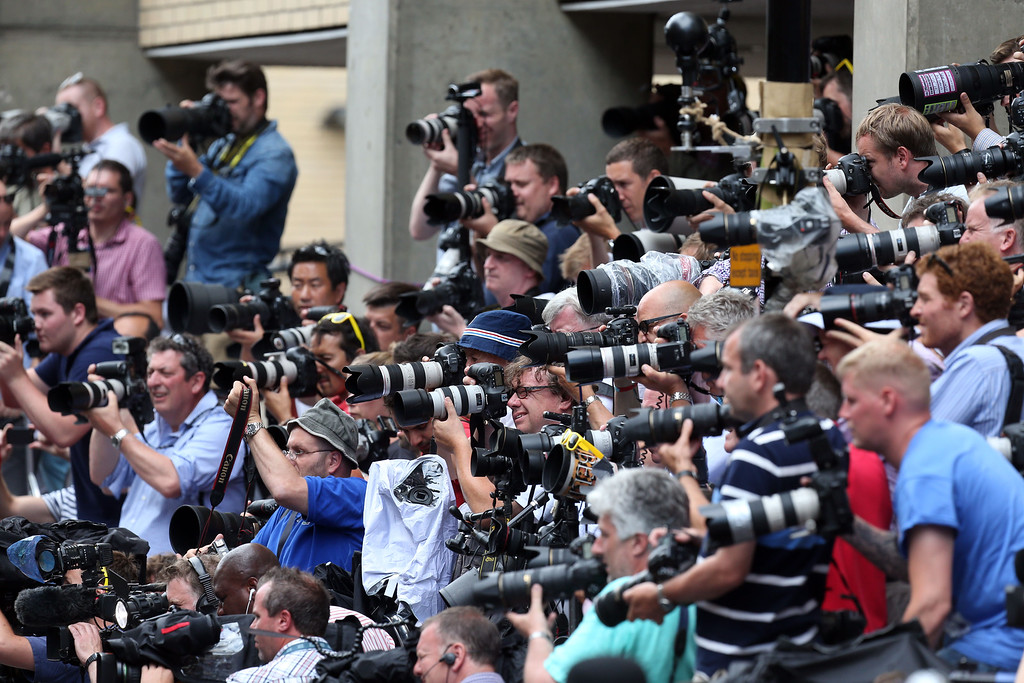 . Photographers take pictures of The Duchess of Cambridge\'s parents Carole and Michael Middleton as they arrive at the Lindo Wing of St Mary\'s Hospital in London, to meet their new grandson Tuesday, July 23, 2013. Prince William, Kate and their baby boy were spending their first full day as a family Tuesday inside a London hospital, thanking staff for their care but making well-wishers wait for a first glimpse of the royal heir.  (AP Photo / Steve Parsons/PA)