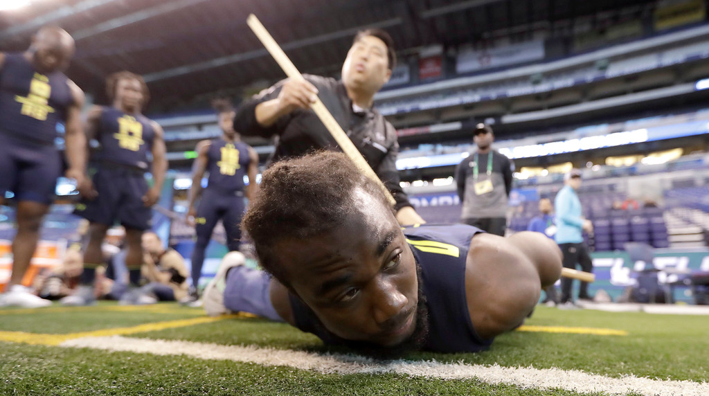 . Florida State running back Dalvin Cook is tested for flexibility at the NFL football scouting combine Friday, March 3, 2017, in Indianapolis. (AP Photo/David J. Phillip)