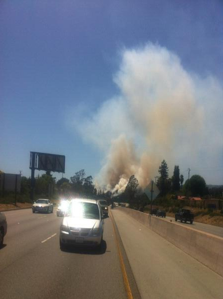 . Smoke billows into the air on the side of Highway 17 approaching Santa Cruz. (Eric Kingsbury/Contributed)