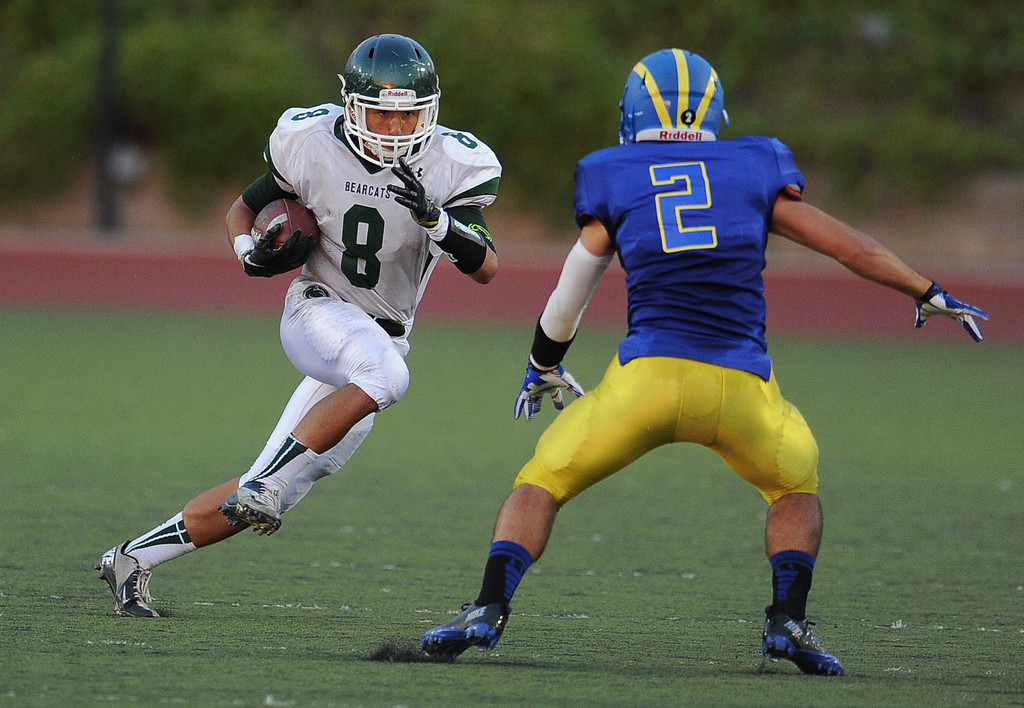 . Bonita\'s Christian Ramos (8) runs for yardage against Mitchell Giles (2) in the first half of a prep football game at Citrus College on Thursday, Aug. 29, 2013 in Glendora, Calif.   (Keith Birmingham/Pasadena Star-News)