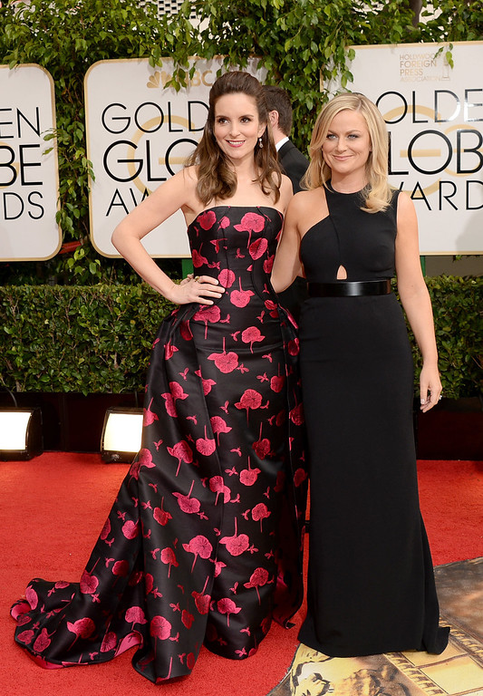 . Actresses Tina Fey (L) and Amy Poehler attend the 71st Annual Golden Globe Awards held at The Beverly Hilton Hotel on January 12, 2014 in Beverly Hills, California.  (Photo by Jason Merritt/Getty Images)