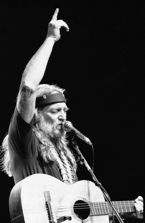 . Willie Nelson performs at Radio City Music Hall in New York, May 24, 1984. It is the first in a series of of six concerts at Radio City, all of which sold out, the first time for a country western act. (AP Photo/Richard Drew)