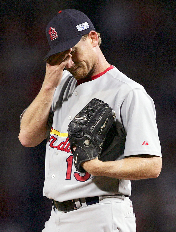 . St. Louis Cardinals starter Woody Williams reacts during the first inning against the Boston Red Sox during Game 1 of the World Series Saturday, Oct. 23, 2004 in Boston. (AP Photo/Charles Krupa)