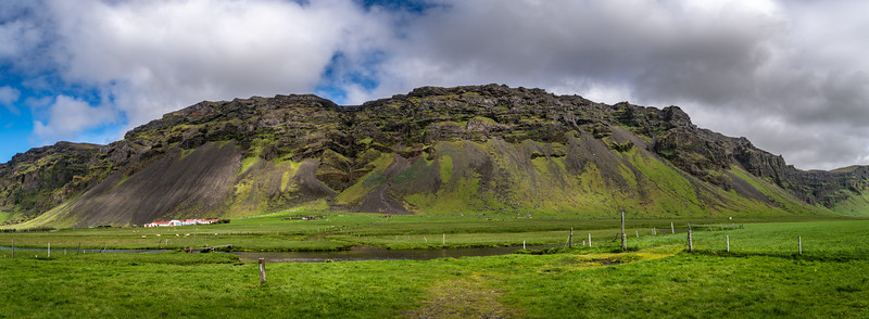 Iceland Farm at bast of Mountains    Photography by Wayne Heim