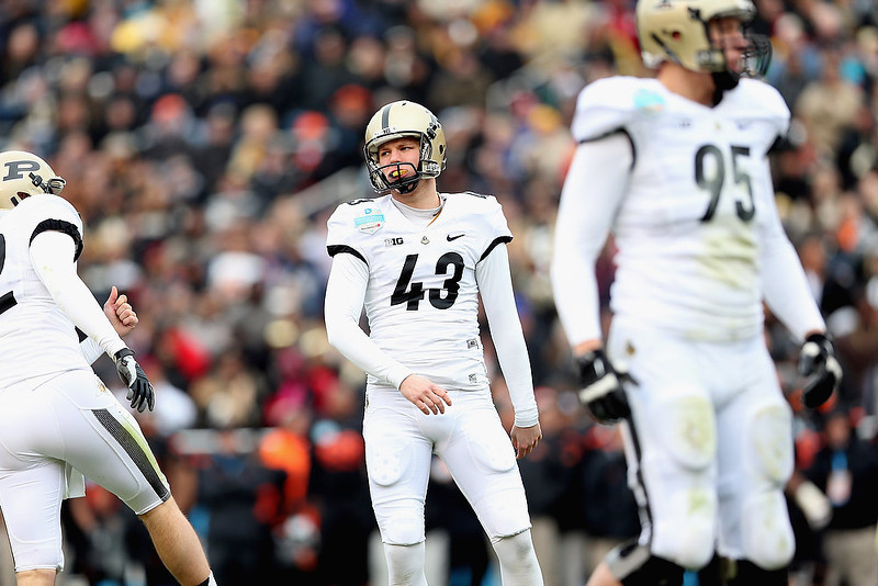 . Sam McCartney #43 of the Purdue Boilermakers reacts after missing a field goal attempt against the Oklahoma State Cowboys during the Heart of Dallas Bowl at Cotton Bowl on January 1, 2013 in Dallas, Texas.  (Photo by Ronald Martinez/Getty Images)