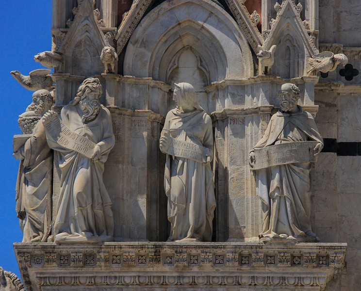 Detailed sculptures wrap around the edges of the Siena Cathedral, each telling part of a story.