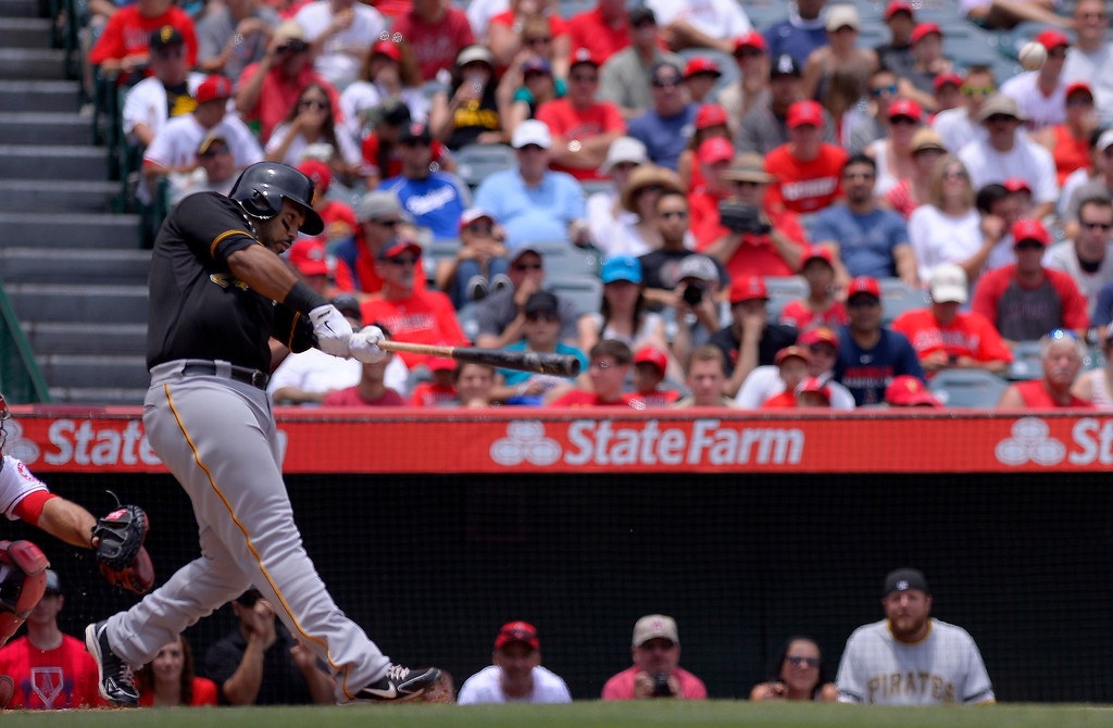 . Pittsburgh Pirates\' Pedro Alvarez hits a solo home run during the first inning of their baseball game against the Los Angeles Angels, Sunday, June 23, 2013, in Anaheim, Calif.  (AP Photo/Mark J. Terrill)