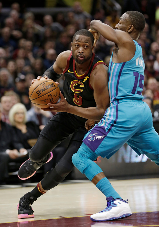 . Cleveland Cavaliers\' Dwyane Wade, left, drives past Charlotte Hornets\' Kemba Walker in the first half of an NBA basketball game, Friday, Nov. 24, 2017, in Cleveland. (AP Photo/Tony Dejak)