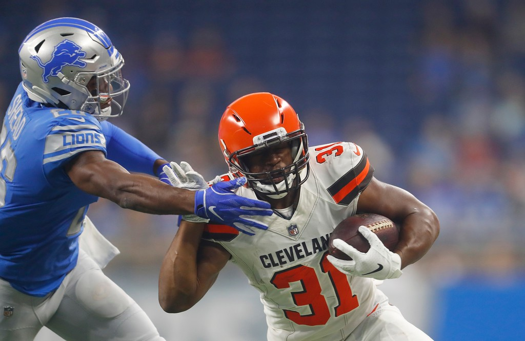 . Detroit Lions defensive back DeShawn Shead (26) reaches in on Cleveland Browns running back Nick Chubb (31) during the first half of an NFL football preseason game, Thursday, Aug. 30, 2018, in Detroit. (AP Photo/Paul Sancya)