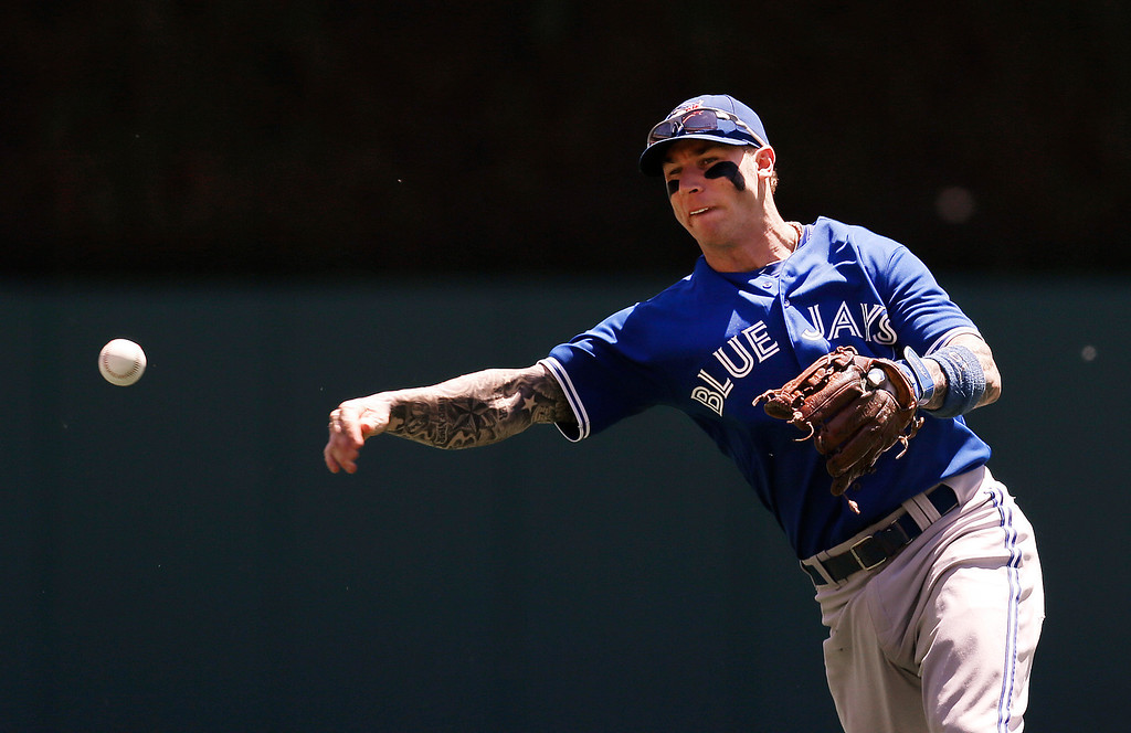 . Toronto Blue Jays second baseman Brett Lawrie throws out Detroit Tigers\' J.D. Martinez in the second inning of a baseball game in Detroit, Thursday, June 5, 2014. (AP Photo/Paul Sancya)