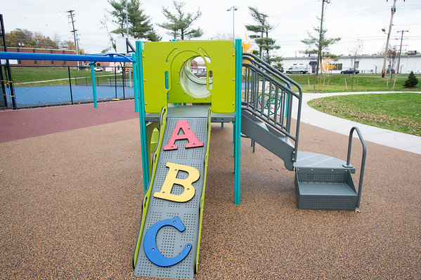 11/04/19 Wesley Bunnell | StaffrrA ribbon cutting was held at Chesley Park celebrating the completion of the Phase 2 renovation project. A climbing wall on the new playground is shown.