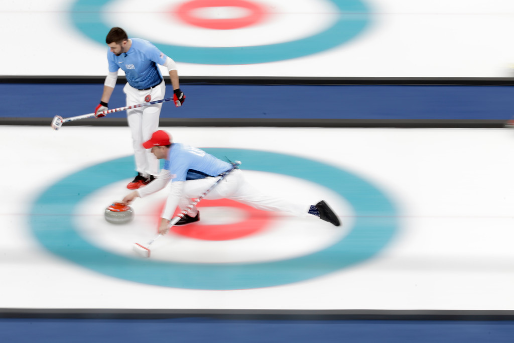 . United States\'s skip John Shuster throws a stone during a men\'s curling match against Japan at the 2018 Winter Olympics in Gangneung, South Korea, Sunday, Feb. 18, 2018. (AP Photo/Natacha Pisarenko)
