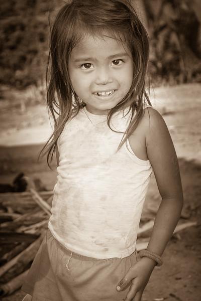 Touching portrait of a cute kid met in the rural area of El Nido.