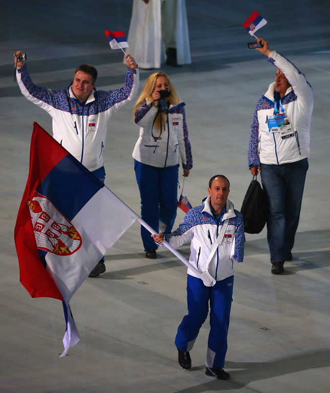 . Jugoslav Milosevic of Serbia bears the flag during the Opening Ceremony of the Sochi 2014 Paralympic Winter Games at Fisht Olympic Stadium on March 7, 2014 in Sochi, Russia.  (Photo by Hannah Peters/Getty Images)
