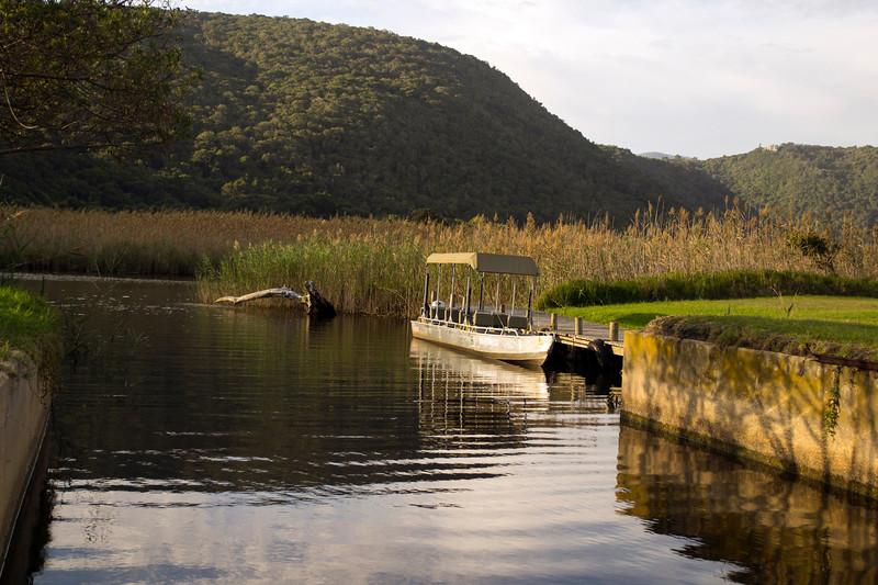 river boat docked on river side