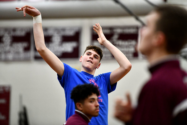 2/11/2020 Mike Orazzi | StaffrBristol Central High School's Donovan Clingan (32) warms up before Tuesday night's game with Maloney in Bristol.