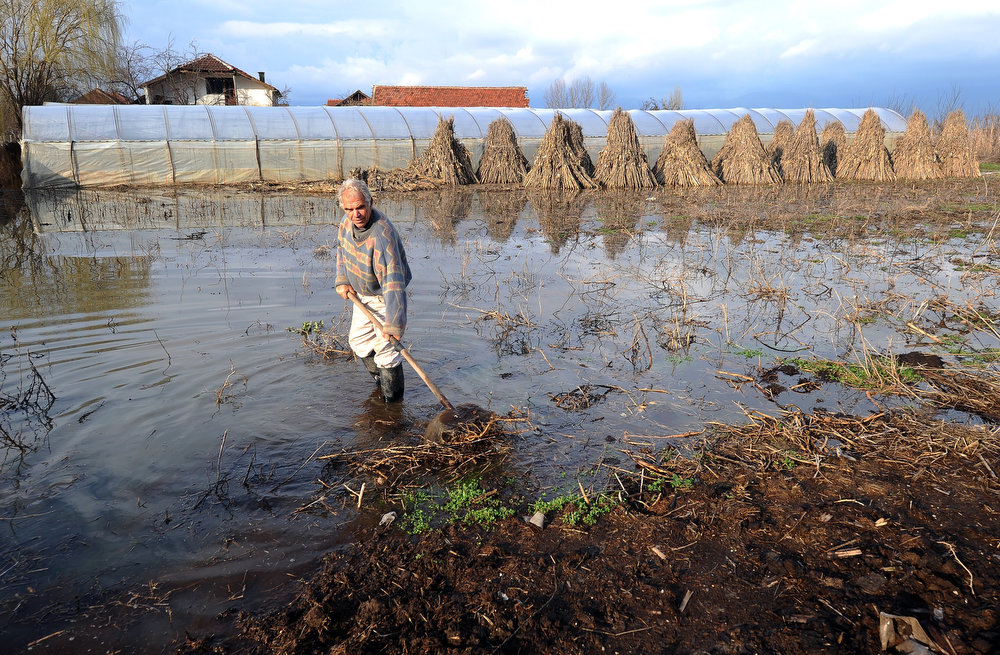 Description of . A farmer tries to clear the debris off his field in the village of Monospitovo, in the southeastern tip of the Republic of Macedonia on February 27, 2013. The torrential rains which in the last three days poured down on the fertile Strumica Valley inundated fields and villages, destroying or damaging crops and households. Tens of people in the region are now sheltered, as their homes were gravely damaged. ROBERT ATANASOVSKI/AFP/Getty Images