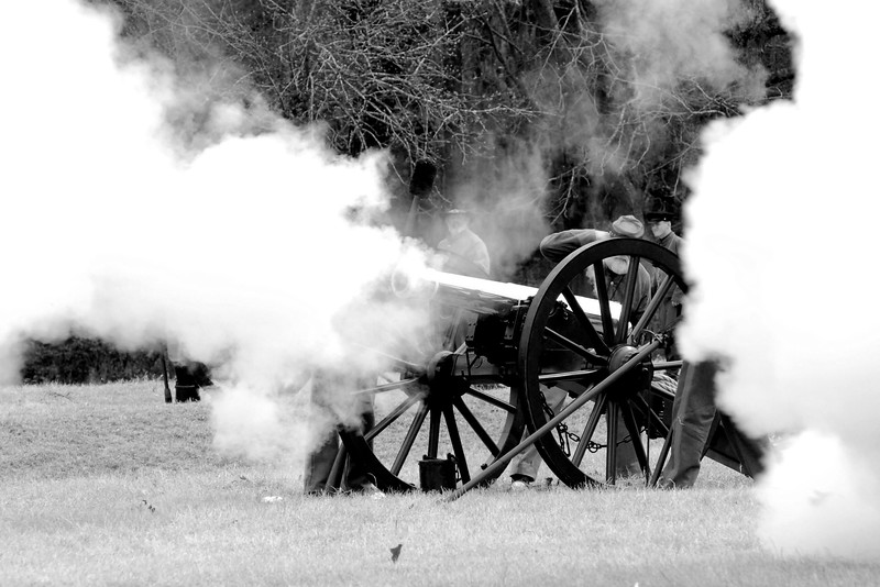 Smoke obscures a Confederate artillery bronze Parrott Rifle. The Skirmish at Gamble's Hotel happened on March 5, 1885 when 500 federal soldiers, under the command of Reuben Williams of the 12th Indiana Infantry, marched into Florence to destroy the railroad depot but were met by Confederate soldiers backed up with 400 militia. The reenactment, held by the 23rd South Carolina Infantry, was held at the Rankin Plantation in Florence, South Carolina on Saturday, March 5, 2011. Photo Copyright 2011 Jason Barnette
