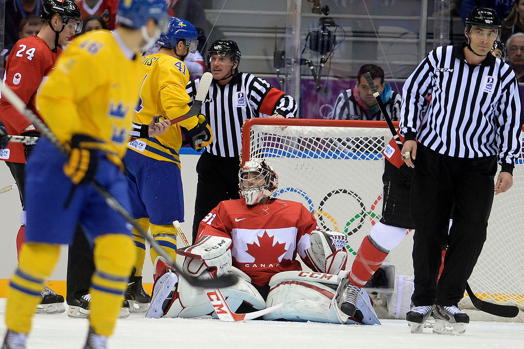 . Carey Price (31) of Canada reacts to making a stop on a near goal by Gustav Nyquist (41) of Sweden during the first period of the men\'s ice hockey gold medal game. Sochi 2014 Winter Olympics on Sunday, February 23, 2014 at Bolshoy Ice Arena. (Photo by AAron Ontiveroz/ The Denver Post)