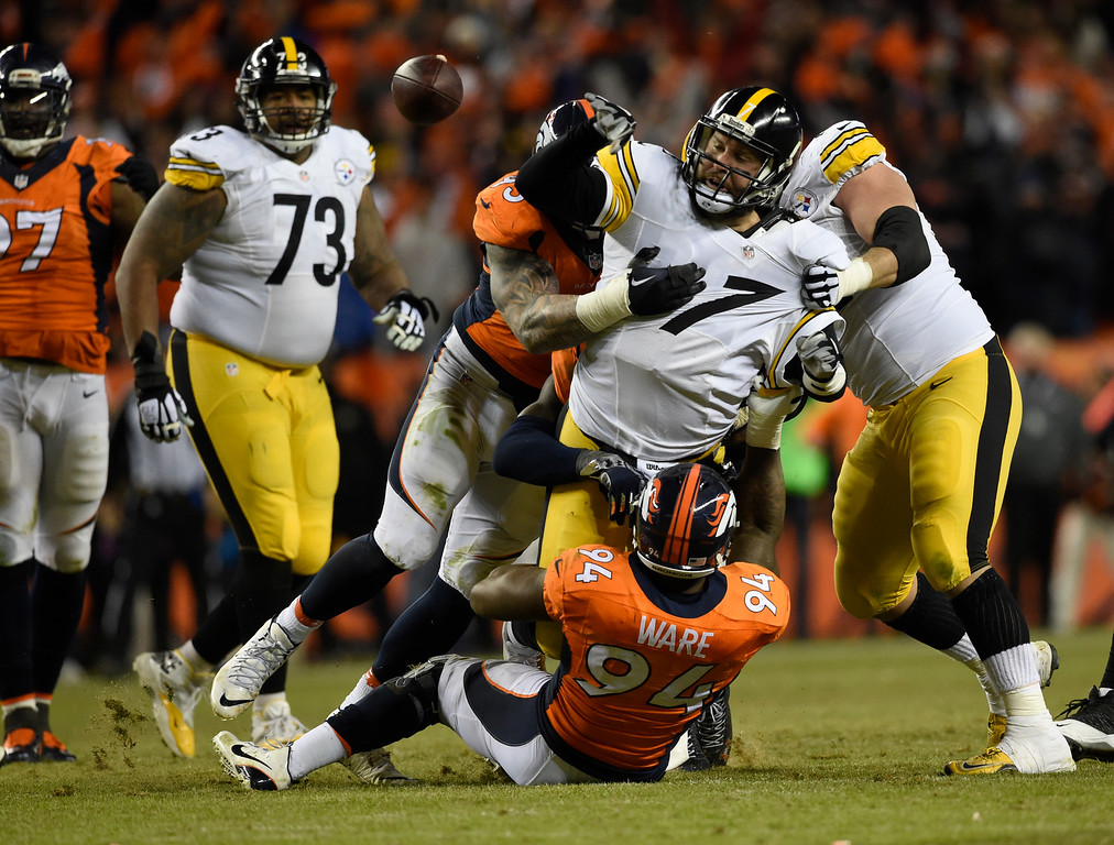 . Denver Broncos defensive end Derek Wolfe (95) and Denver Broncos outside linebacker DeMarcus Ware (94) put pressure on Pittsburgh Steelers quarterback Ben Roethlisberger (7) as he loses the ball during the fourth quarter January 17, 2016 in the Divisional Round Playoff game at Sports Authority Field at Mile High Stadium. Ben Roethlisberger was ruled down on the play. (Photo By Helen Richardson/The Denver Post)