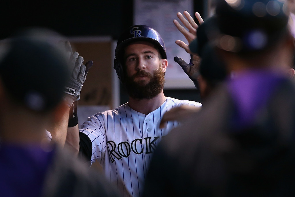 . DENVER, CO - AUGUST 14:  Charlie Blackmon #19 of the Colorado Rockies celebrates after scoring on a sacrifice fly by Corey Dickerson #6 of the Colorado Rockies to tie the score 2-2 with the Cincinnati Reds in the third inning at Coors Field on August 14, 2014 in Denver, Colorado.  (Photo by Doug Pensinger/Getty Images)